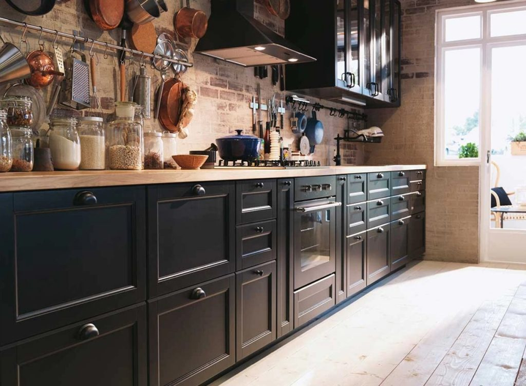 A Single Wall Kitchen With Rustic Backsplash
