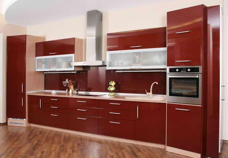 Bold Red One Wall Kitchen Design With Contrast From Wood Flooring