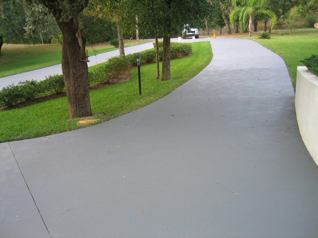 Asphalt And Concrete Driveway At Modern Home. Contemporary Driveway Ideas