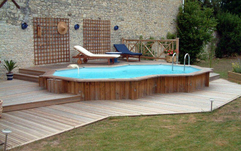 Small Above Ground Pool with Wooden Deck and Lounge