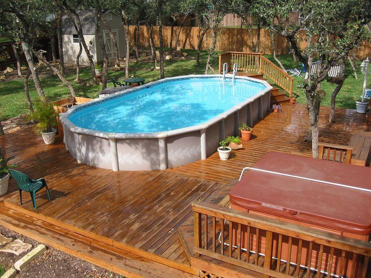 Above ground pool with playground deck