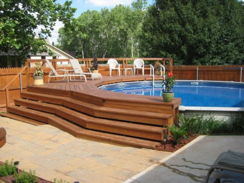 picture of above ground pool with wooden deck
