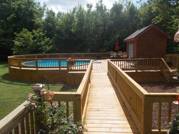 Picture Of A Circular Deck With Bridge And Above Ground Pool