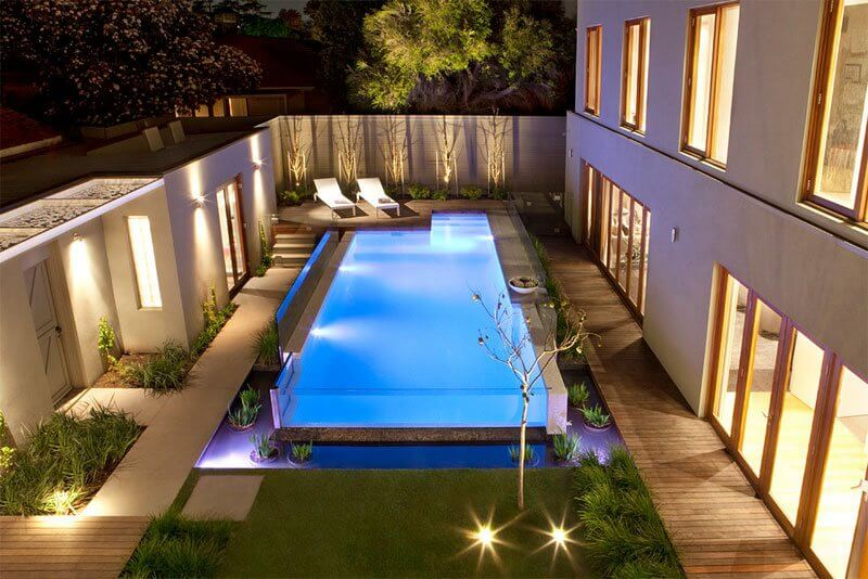 Above ground pool with deck benefits cost and ideas for Fancy swimming pool designs