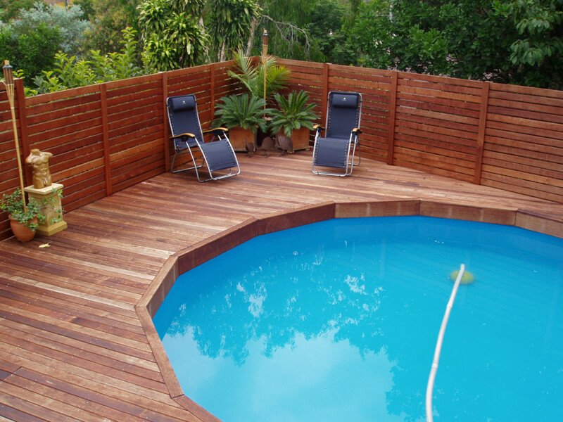 Round above ground pool with wood decking