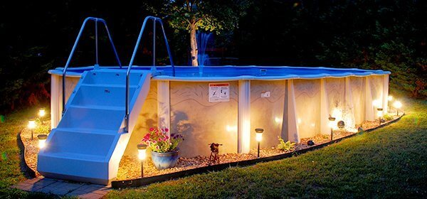 Above ground pool with deck benefits cost and ideas for Above ground pool lighting ideas