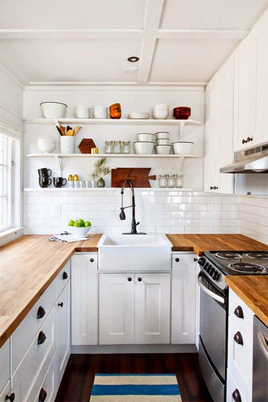 U shaped kitchen with white cabinet