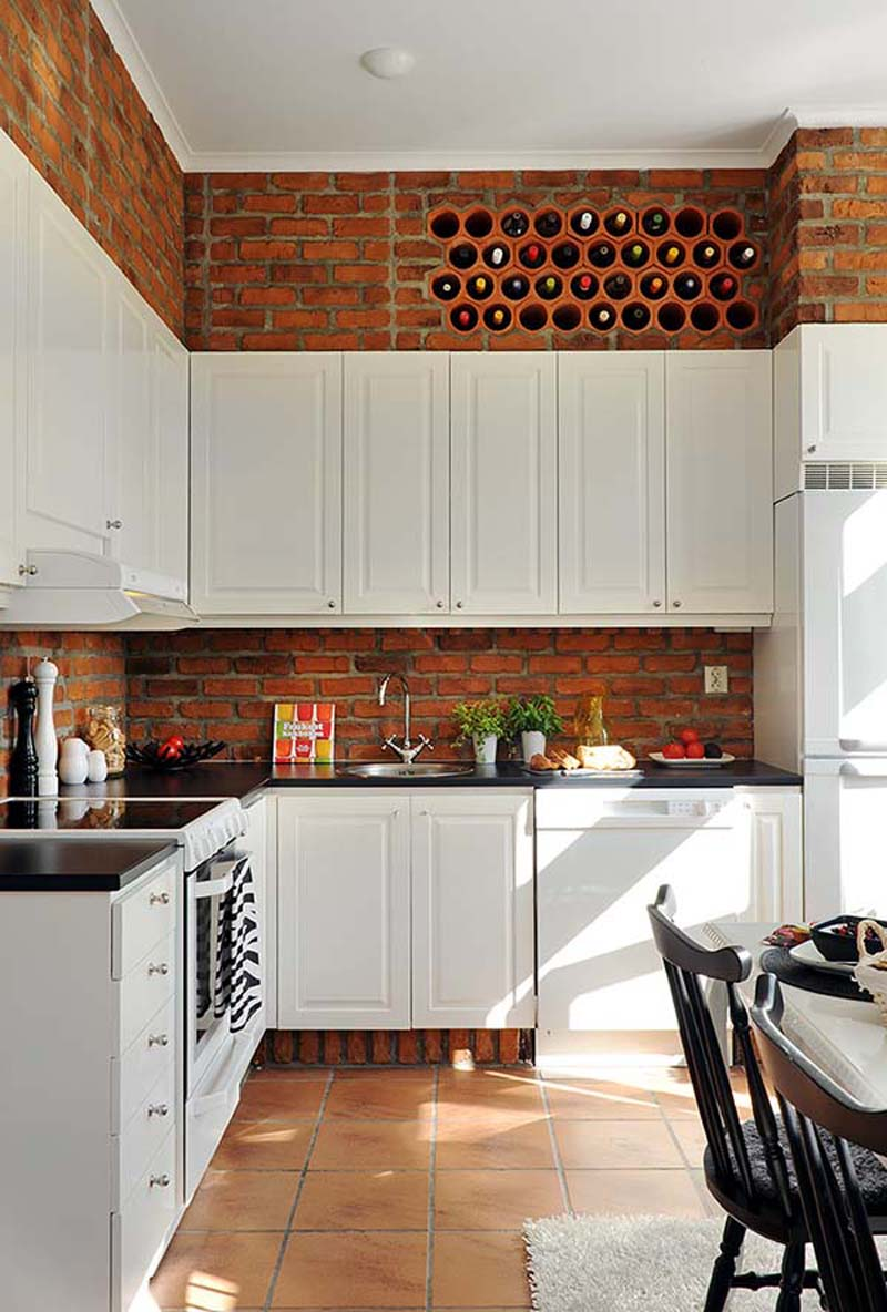 brick backsplash white kitchen cabinet