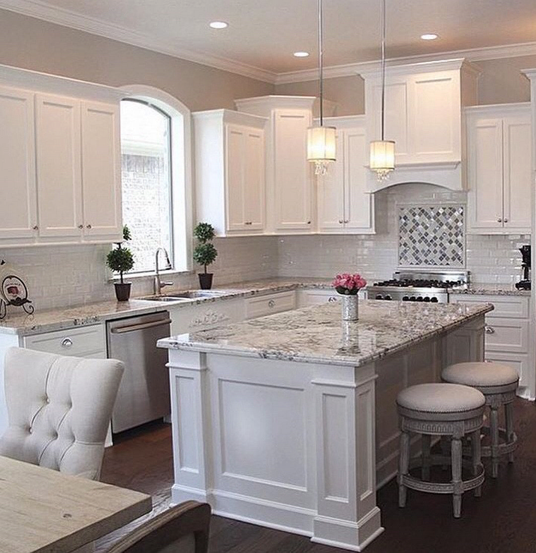 white kitchen island with granite countertop