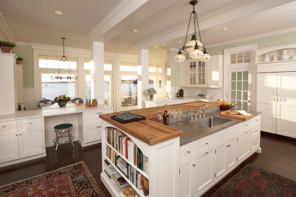 white kitchen island with stovetop