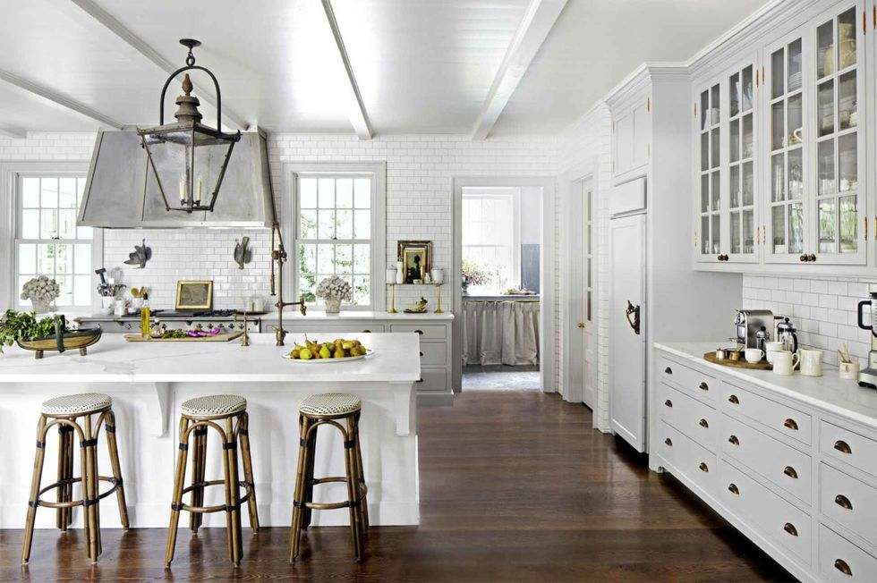 white kitchen with dark floor