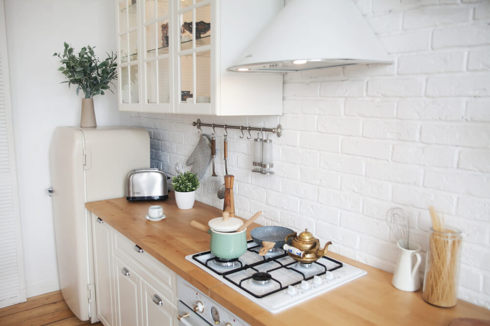 White-painted brick kitchen backsplash