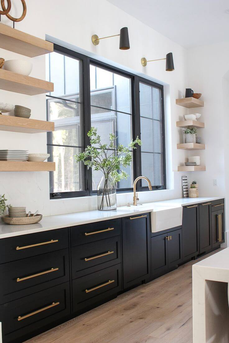 black kitchen cabinet with gold handles