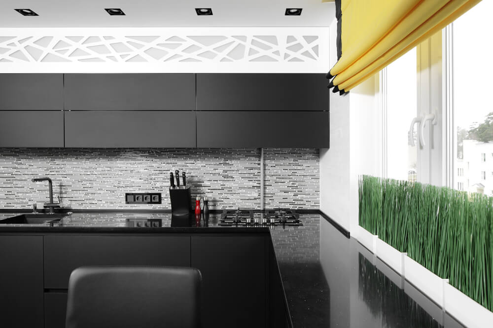 black kitchen cabinets with black countertop