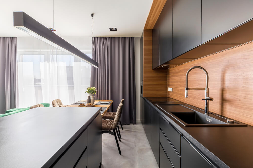 black kitchen cabinet with black countertop
