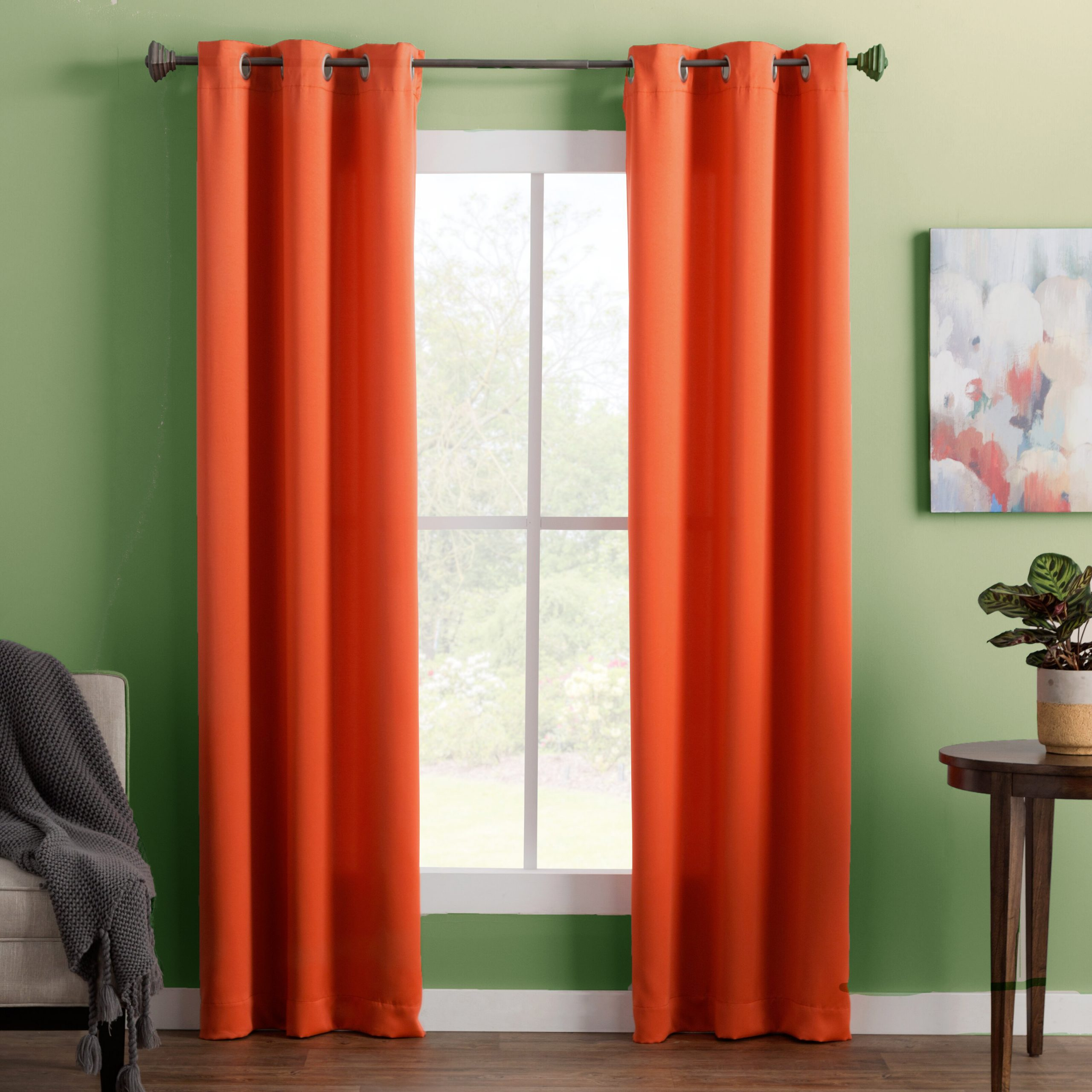 Tangerine Curtains Pop Beautifully Against Green Walls