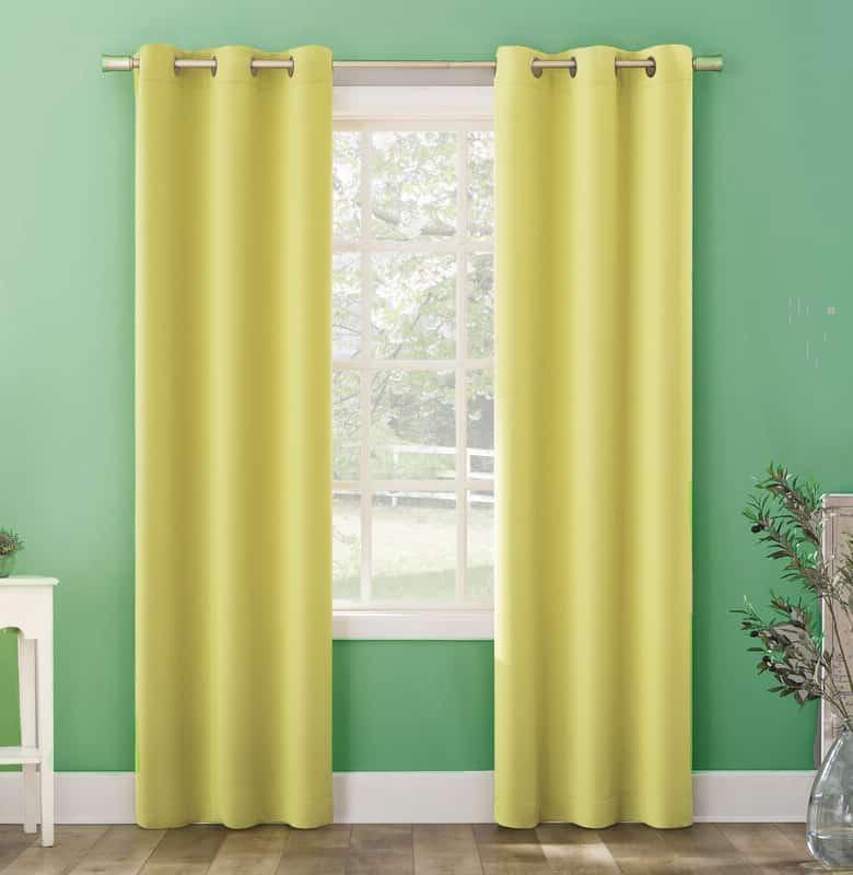 Lemon Yellow Curtains Pop Against Green Walls