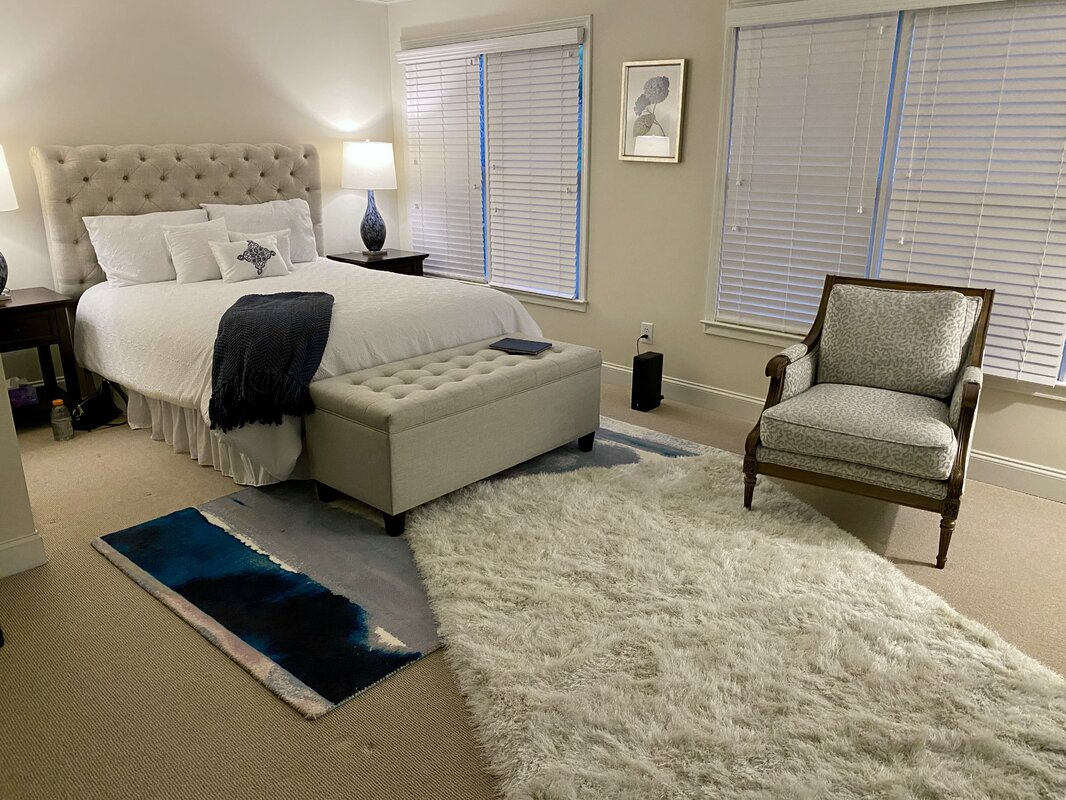 Layer the Contrasting Textural Rugs