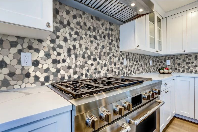 Choose a Pebble-Shaped Backsplash for a Natural Touch